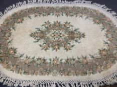 GANGES HANDMADE ALL WOOL PILE INDIAN CARPET, oval format, cream ground with full outer border and