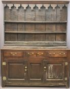CIRCA 1760 WELSH OAK DRESSER having a three shelf stepped rack with thick backboards and later