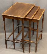 EDWARDIAN CROSSBANDED MAHOGANY NEST OF THREE SPIDER LEG OCCASIONAL TABLES, 65cms H, 56cms W, 37cms D