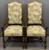 VINTAGE OAK COTTAGE STYLE ARMCHAIRS having animal adorned tapestry covers to the seats and backs,