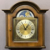 WALT REPRODUCTION WALNUT GRANDMOTHER CLOCK with moon face detail to an arched dial before a pendulum