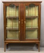 EDWARDIAN MAHOGANY TWO DOOR CHINA DISPLAY CABINET with boxwood and ribbon swag applied detail,