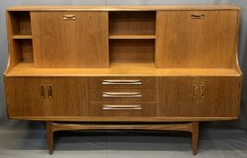 MID-CENTURY LONG TEAK SIDEBOARD with drop down top cupboards and central shelf over three central