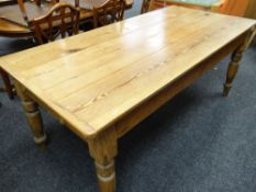 VICTORIAN PINE KITCHEN TABLE, with boarded top and cleated ends, turned legs, 186 x 90cms