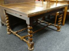 JACOBEAN-STYLE OAK DRAW LEAF DINING TABLE, barley-twist legs and double stretchers, bun feet, 212cms