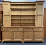 LARGE ANTIQUE PINE COUNTRY HOUSE KITCHEN DRESSER, boarded plate rack with flanking cupboards, a base