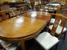 MODERN CHINESE HARDWOOD EXTENDING OVAL DINING TABLE & EIGHT CHAIRS, table with panelled top and