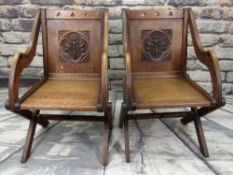 PAIR OF ARTS & CRAFTS OAK GLASTONBURY CHAIRS, square panelled backs carved with flowering lily