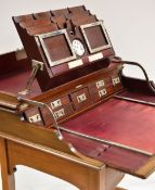 FINE EDWARDIAN MAHOGANY 'CAMPAIGN-TRAVEL' DESK, c.1910, plain hinged top opening to reveal a