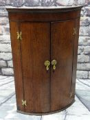18TH CENTURY OAK & MAHOGANY CROSS BANDED BOWFRONT HANGING CORNER CUPBOARD, 103cms high