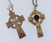TWO SIMILAR CELTIC GOLD CROSS PENDANTS comprising 9ct example on chain together with 14K example