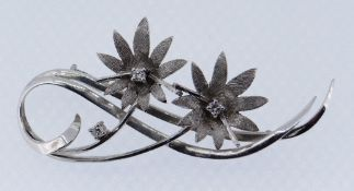 WHITE METAL DIAMOND SET FLORAL BROOCH, 7.9gms Condition Report: Hallmarks rubbed. Appears in good