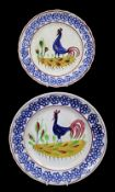 PAIR OF LLANELLY COCKEREL PLATES typically decorated with sponged floral motifs to the border,