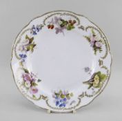 A NANTGARW PORCELAIN PLATE DECORATED BY WILLIAM POLLARD of alternate lobed form, the border