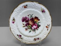 A NANTGARW PORCELAIN LONDON DECORATED PLATE having a border moulded with c-scrolls, ribbons and