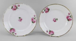 A PAIR OF NANTGARW PORCELAIN PLATES of circular form, finely painted with four sprigs of pink open