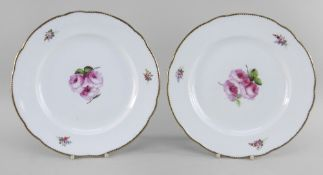 A PAIR OF NANTGARW PORCELAIN PLATES of lobed form, both painted with open pink roses and foliage,