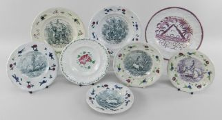 EIGHT YNYSMEUDWY POTTERY CHILDREN'S PLATES all with floral moulded borders, comprising two from a