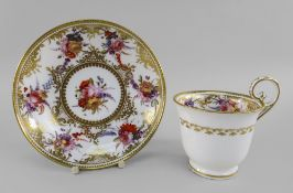 A NANTGARW PORCELAIN CUP & SAUCER the footed bell shaped cup with elevated loop handle, both