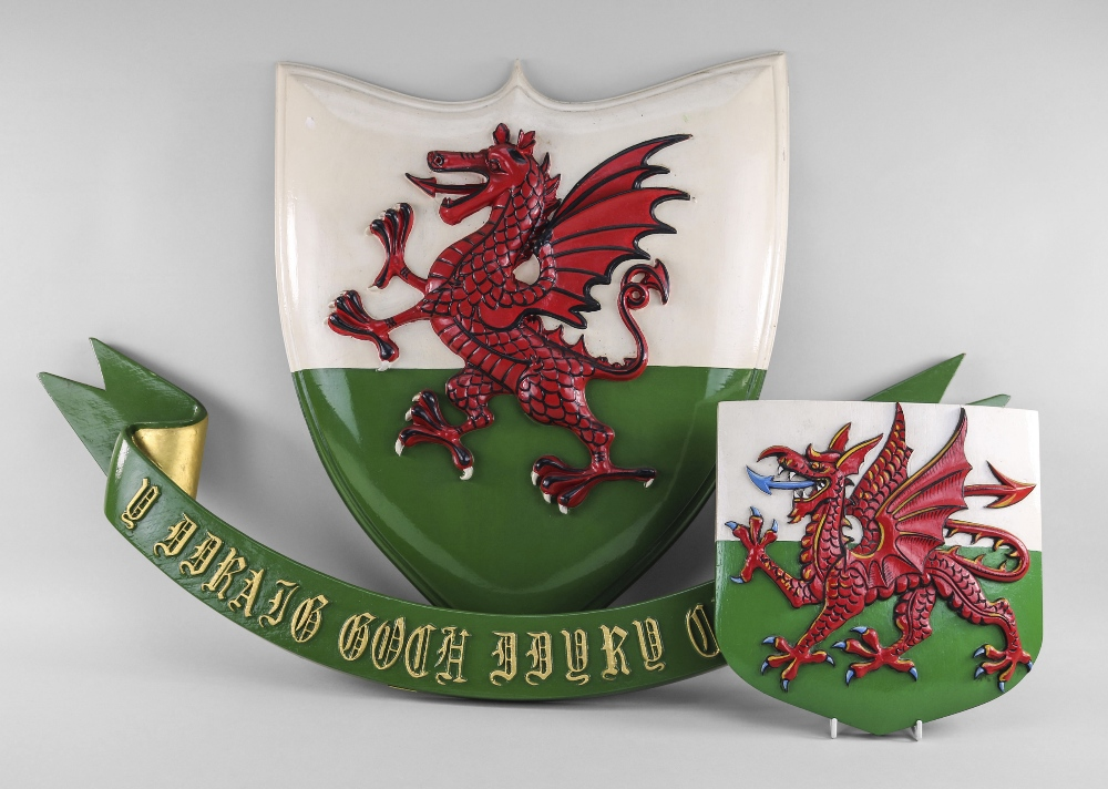 TWO PAINTED WOODEN WELSH DRAGON PLAQUES the dragons relief carved, 58cms and 25cms high, together