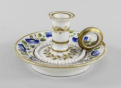 A RARE SWANSEA PORCELAIN MINIATURE TAPERSTICK of circular form with ring handle and stepped nozzle