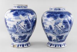 NEAR PAIR OF 18TH CENTURY DELFT BLUE & WHITE JARS, c. 1750, probably English, painted with two large