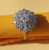 GRAFF 18CT WHITE GOLD DIAMOND CLUSTER RING, the central diamond (0.6cts approx.) surrounded by a