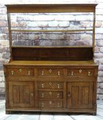 18TH CENTURY NORTH WALES OAK DRESSER, open delft rack above base fitted with six drawers and two