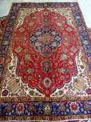 TABRIZ RUG, indigo medallion with pendants on a red floral field, ivory willow tree spandrels,