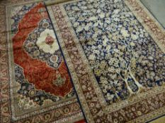 TWO MODERN ORIENTAL SIMULATED SILK RUGS, one a tree of life design in ivory and indigo, 232 x