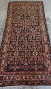 SAROUK REGION RUNNER, allover geometric floral field in russet and grey-blue, ivory border,