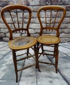 NEAR PAIR VICTORIAN BEECH CHILDRENS' CORRECTIONAL CHAIRS, balloon back and spindle splats, rattan