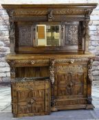 FLEMISH RENAISSANCE-STYLE CARVED OAK CABINET, architectural mirror back top with male and female