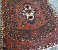 BAKHTIAR RUG, pointed ivory medallion on a soft red and sage green field, cherry border and ivory