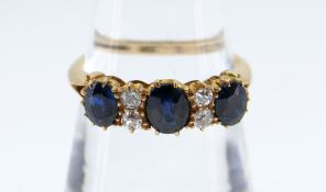 18CT GOLD SAPPHIRE & DIAMOND RING, the three sapphires separated by two pairs of diamonds, claw set,