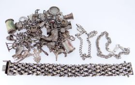ASSORTED SILVER JEWELLERY comprising charm bracelet with multiple and various charms, chunky