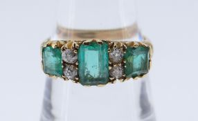 18CT GOLD DIAMOND & EMERALD RING the central emerald 7 x 5mms, ring size P, 5.0gms, in red square