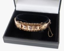 9CT GOLD DIAMOND SET BANGLE, scroll design, 13.4gms, in black box Condition Report: appears in