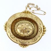 YELLOW METAL MOURNING BAR BROOCH, of oval form with floral design and having locket of hair to