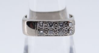 18CT WHITE GOLD DIAMOND SET RING set with eight diamonds, ring size N, 6.3gms, in black square