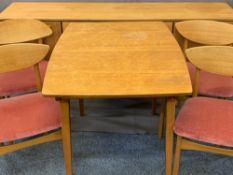 NATHAN TEAK DINING SUITE consisting long sideboard with central three drawers and outer cupboards,