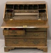 ANTIQUE OAK FALL FRONT BUREAU with interior slide well and good arrangement of drawers and