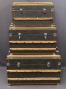 MODERN SET OF THREE VINTAGE STYLE STEAMER TRUNKS, leather effect with wooden banding, 46cms H, 81cms