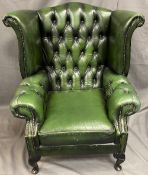 ANTIQUE STYLE GREEN LEATHER EFFECT BUTTON UPHOLSTERED WINGBACK ARMCHAIR, 103cms H, 90cms max W,