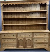 LARGE ANTIQUE STYLE STRIPPED PINE EFFECT DRESSER, the three shelf upper rack with carved detail to