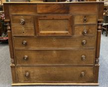 19TH CENTURY OAK CHEST OF 8 DRAWERS, the moulded edge top over a secret central frieze drawer,