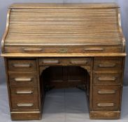 VINTAGE OAK ROLLTOP DESK, the tambour front opening to reveal a fitted interior of pigeonholes and