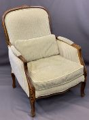 FRENCH STYLE WALNUT & UPHOLSTERED ARMCHAIR having striped, green upholstery and feather filled