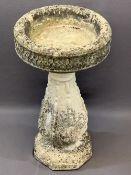 RECONSTITUTED STONE BIRD BATH, the 38cms diameter top on a bulbous column base, 69cms H