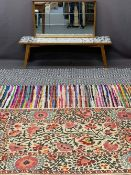 VINTAGE WALL MIRROR, tiled top coffee table and three various woollen rugs, 48 x 84.5cms, 37.5cms H,